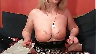 Blonde mature toys her both crevasses on cam