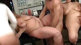 Mature cock loving BBW orgy in a bar